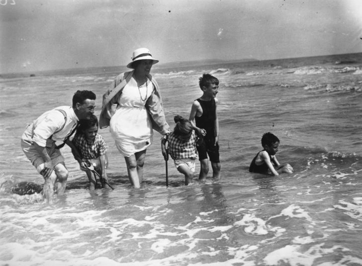 A family plays in the water in 1922.