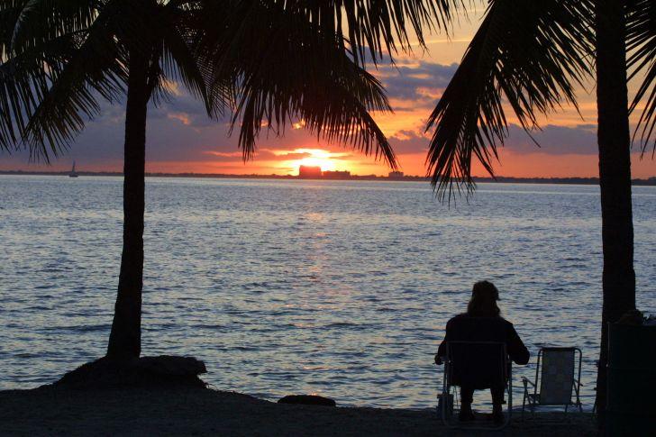 A man watching a sunset.