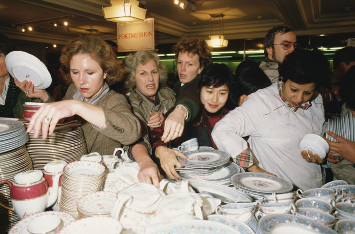Customers jostle to get the best crockery bargains on the first day of the Harrod's sale in 1988.