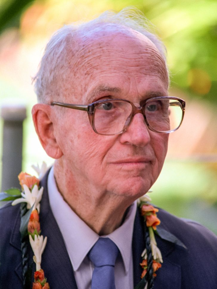 James Michener wearing a flower necklace.