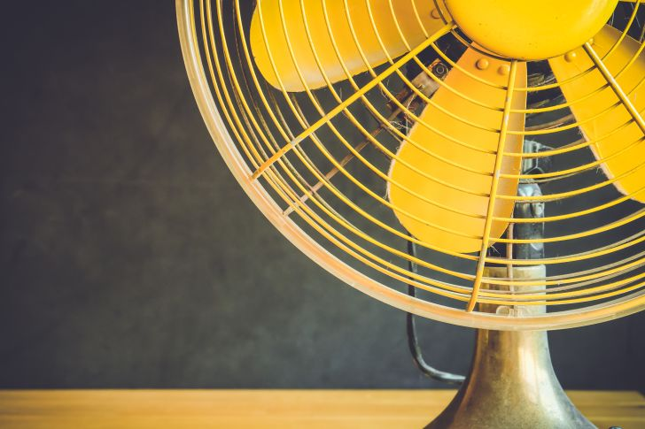 Close-up of a yellow fan.