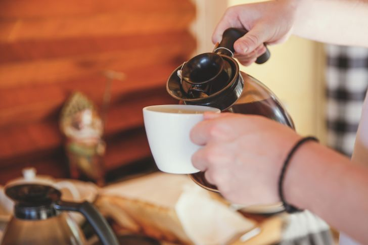 hands pouring coffee