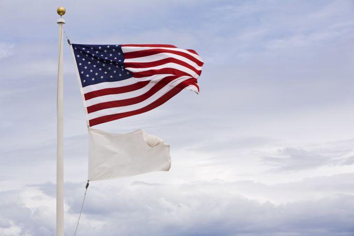 American flag over white flag