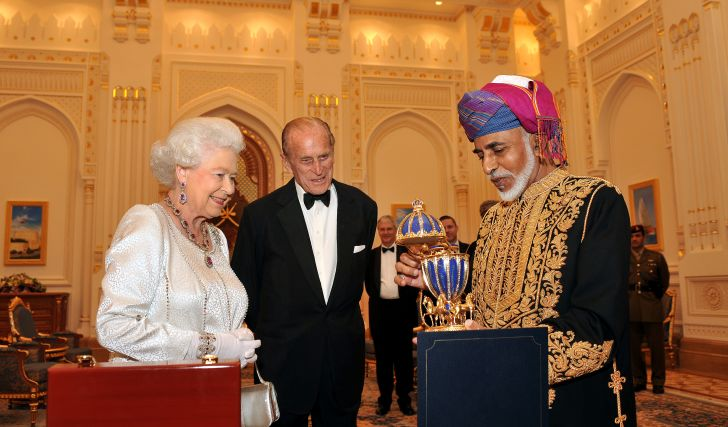 Queen Elizabeth II and Prince Philip, Duke of Edinburgh are presented with a gold musical Faberge style egg by the Sultan of Oman, before a State Banquet at his Palace on November 26, 2010 in Muscat, Oman