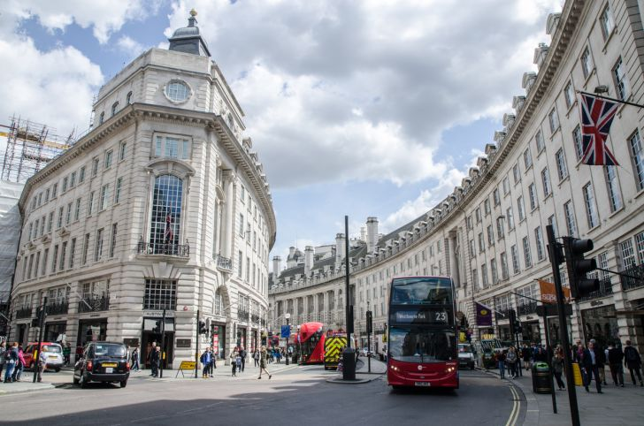 People, cars and double-decker bus passing by London's Regent Street