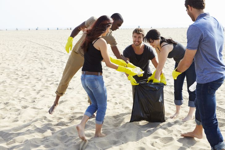 A group of people cleaning up the beach