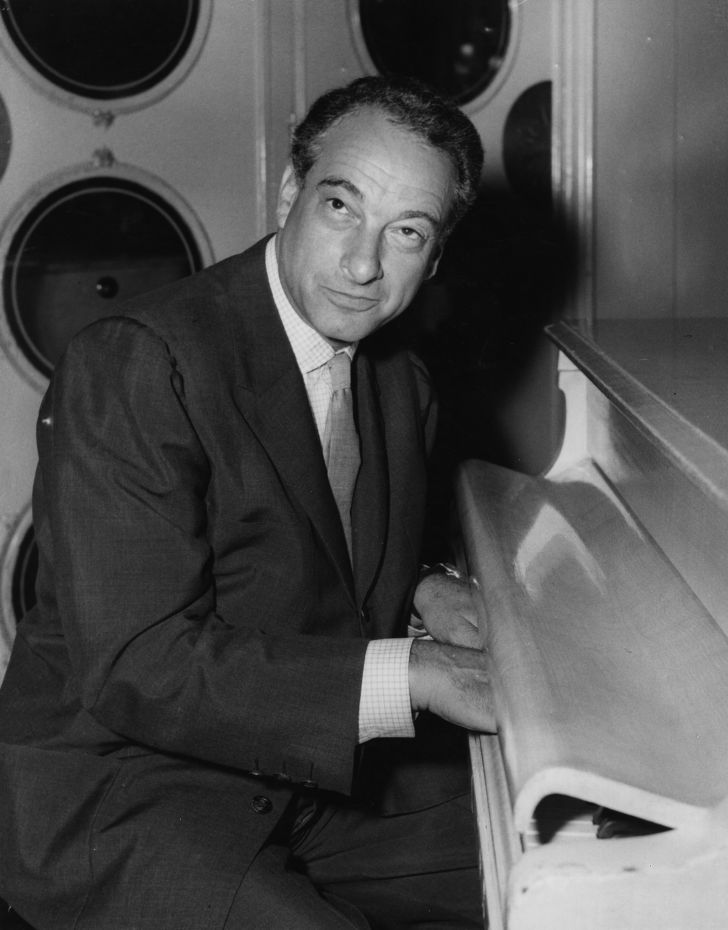 Victor Borge plays the piano.