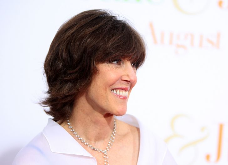 Nora Ephron smiles for press at an event.