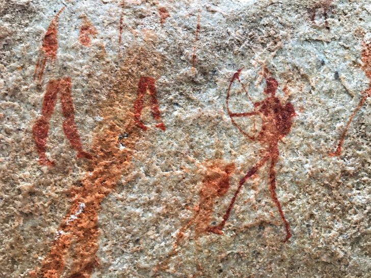 rock art of hunters using bows and arrows