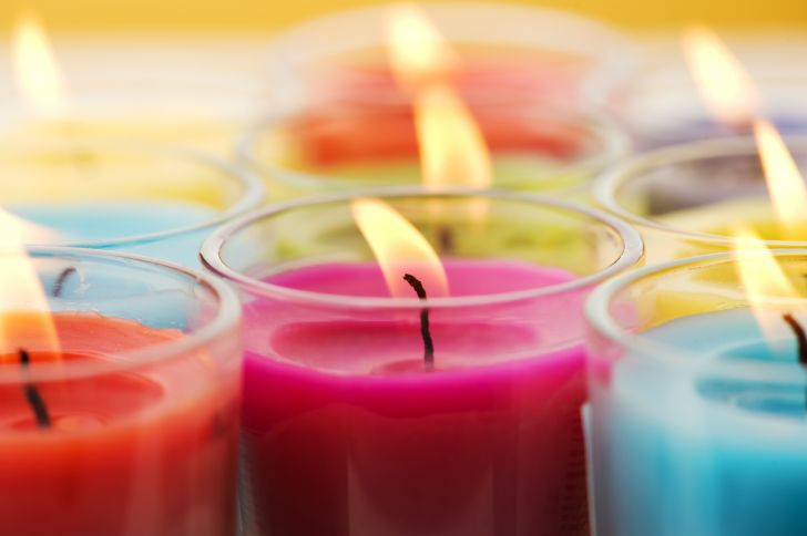 Colorful, lit candles