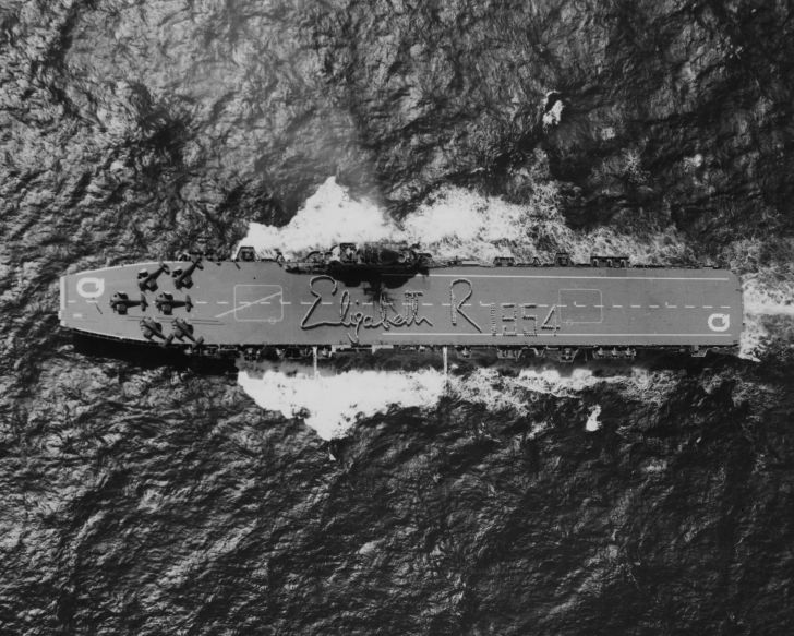 The HMAS Vengeance seen from a helicopter, as the Australian Naval crew spell out the signature of Queen Elizabeth II on the deck, in 1954.