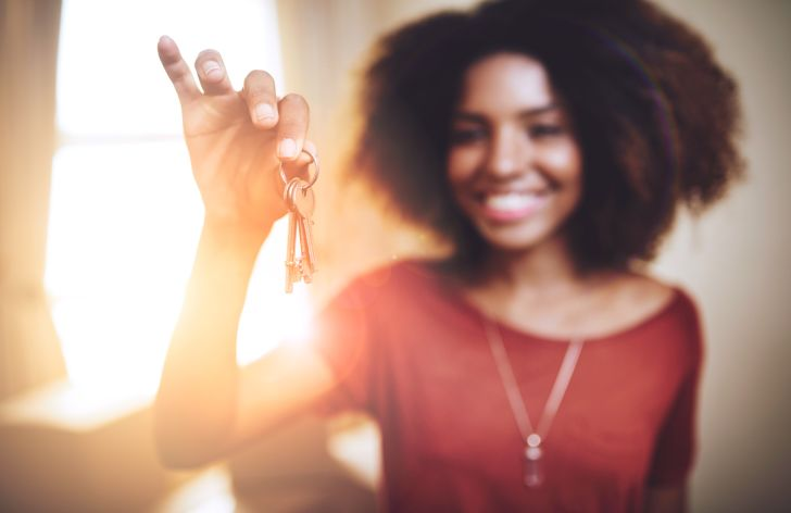 A woman dangles her keys in front of the camera.