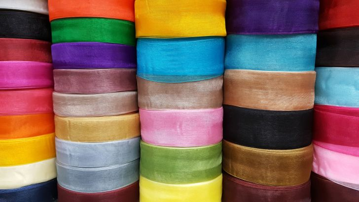 Stacks of colorful spools of ribbon