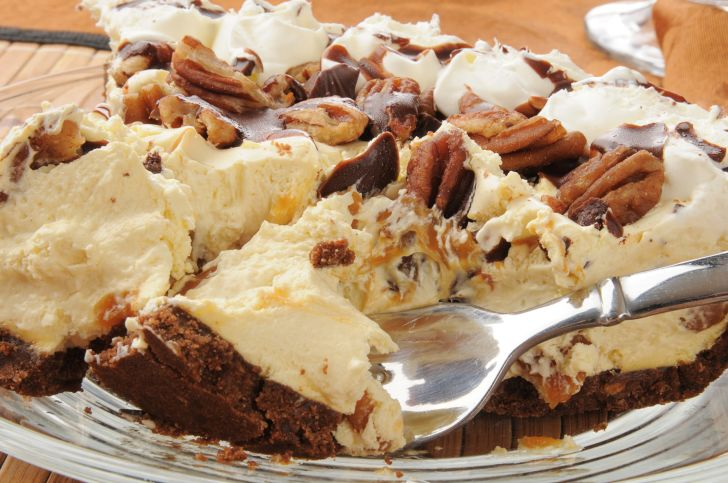 Slice of caramel turtle fudge ice cream pie.
