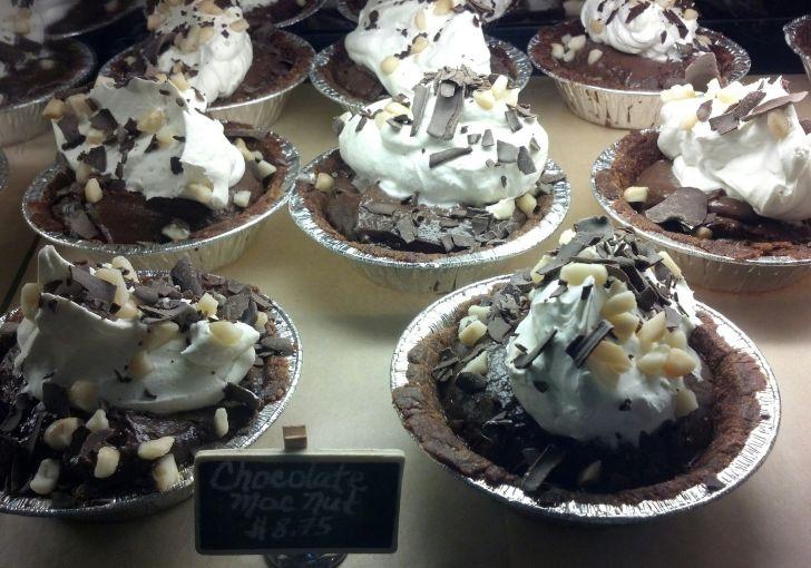 Rows of small chocolate macadamia nut pies.