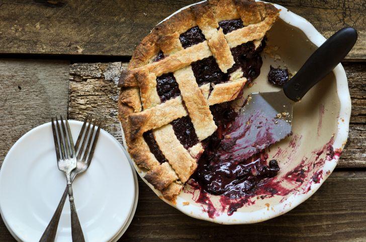 Half of a huckleberry lattice pie.