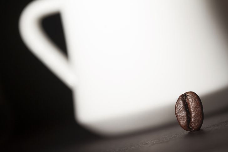 coffee bean next to mug