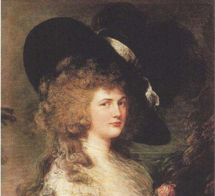 Portrait of woman wearing hat.
