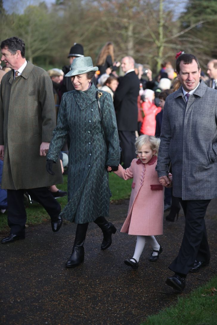 Princess Anne, Princess Royal, Isla Phillips and Peter Phillips attend a Christmas Day church service