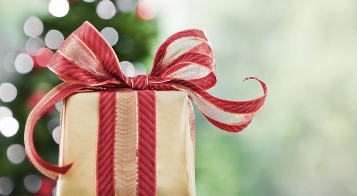 A present wrapped in a wide ribbon.