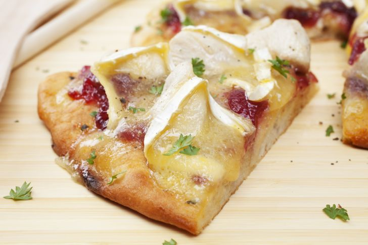Slice of cheese and cranberry pizza.