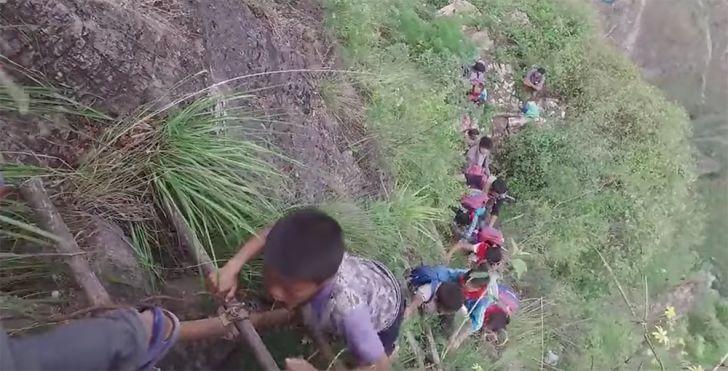 children climbing atuleer ladder
