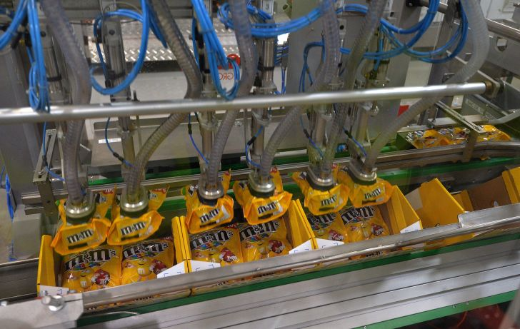 A machine packaging M&M's candies at a Mars factory in France.