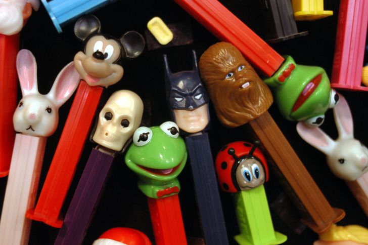 Photos of Pez dispensers, including Mickey Mouse, Kermit, and Batman.