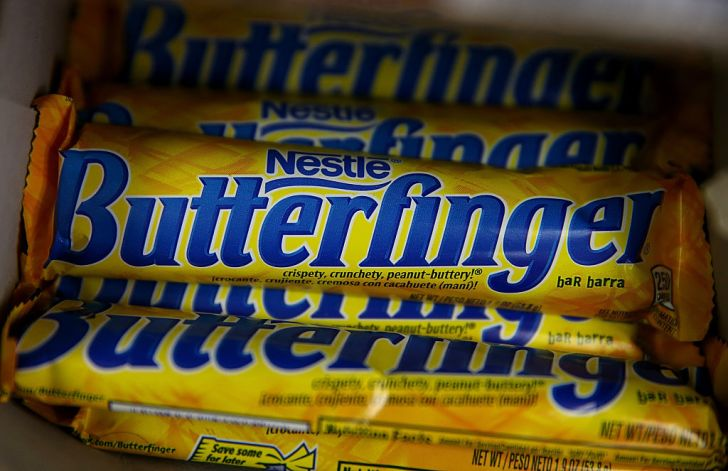 A bunch of Butterfinger candy bars in a box.