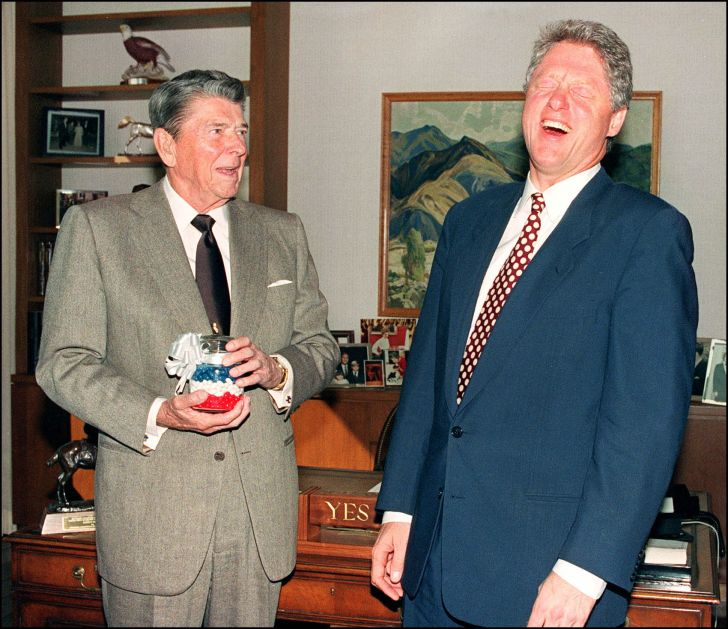 President Ronald Reagan presents president-elect Bill Clinton with a jar of red, white, and blue jelly beans.