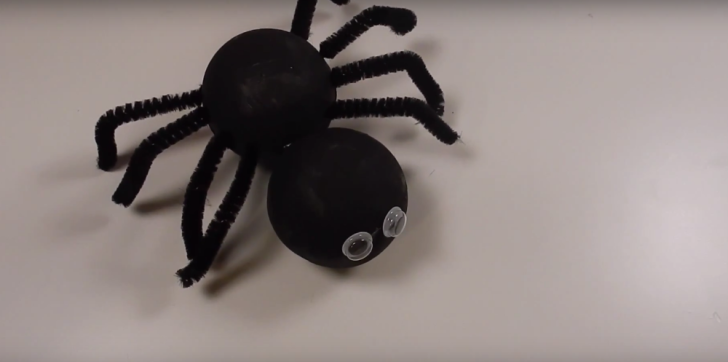 A foam spider with pipe cleaners for legs
