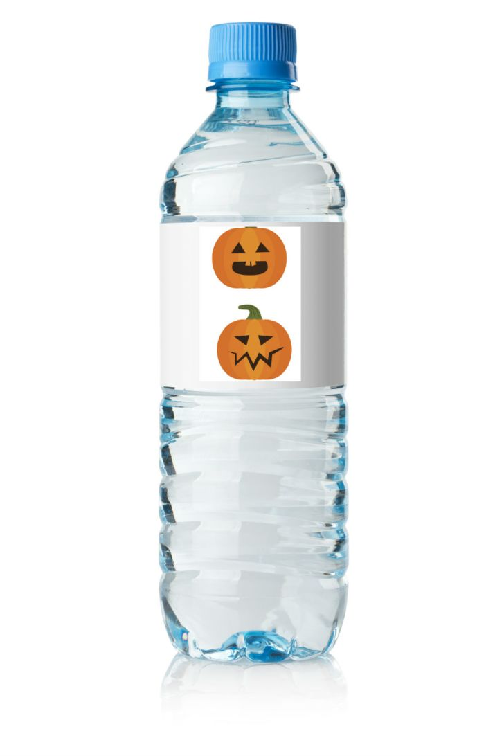 A water bottle features a decorative Halloween label