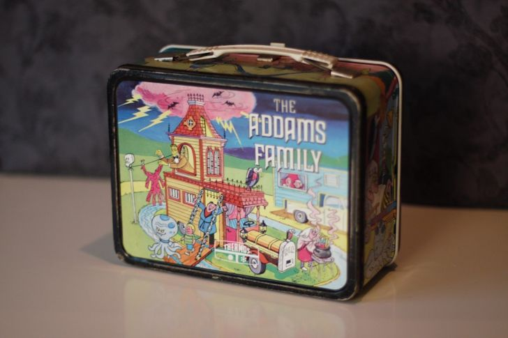 cccc8b7ebfd0 They re creepy and they re kooky ... and they re worth a lot of money. This  metal lunchbox by King Seeley depicts the cartoon version of everyone s  favorite ...