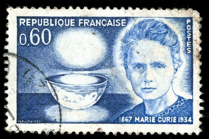 A postage stamp featuring Marie Curie's likeness from France.