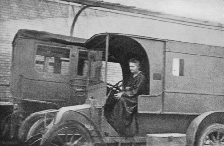 Scientist Marie Curie driving a mobile radiological unit.