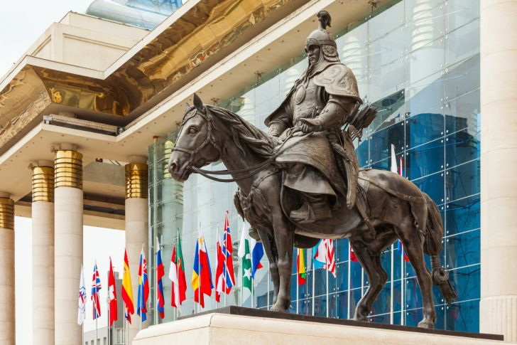 Statues stand guard in front of Genghis Khan's memorial at Chinggis Square in Ulaanbaatar, Mongolia.