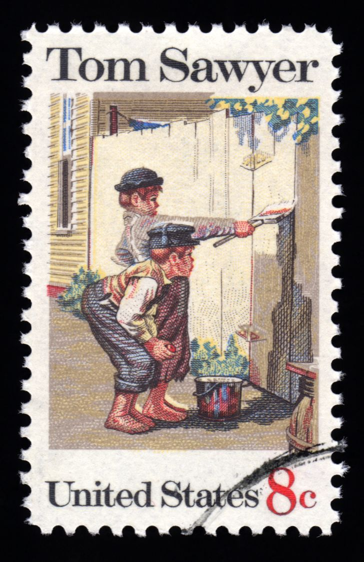 A U.S. postage stamp featuring Mark Twain's Tom Sawyer.