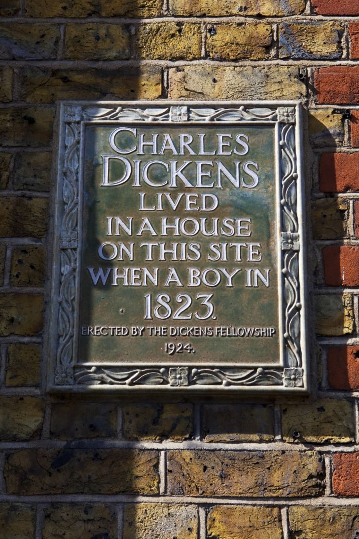 Plaque showing the home of author Charles Dickens.