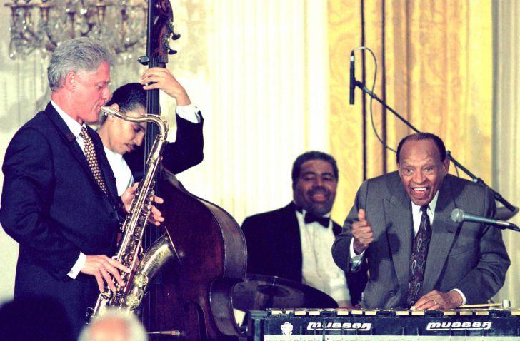 President Bill Clinton playing the saxophone.