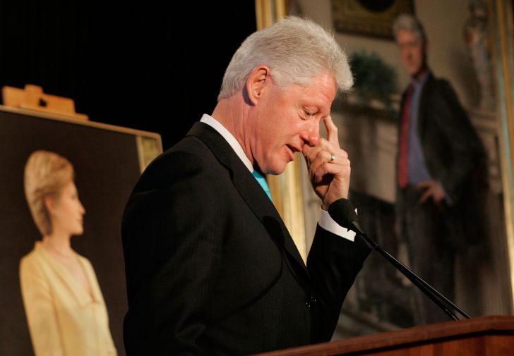 President Bill Clinton in front of his presidential portrait.