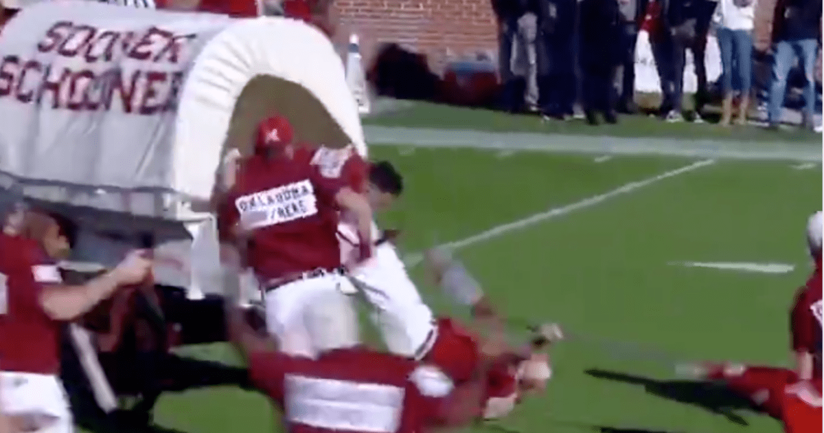 VIDEO: Sooner Schooner Literally Pulled a Man All Over the Field After He Fell Out   12up