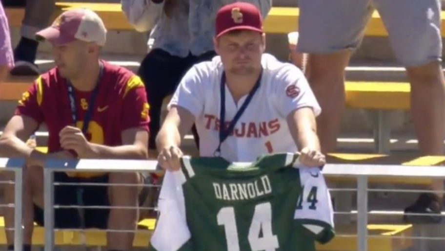 new product 6303f 2e687 USC Fan Holds Up Sam Darnold Jets Jersey in Strange Display ...