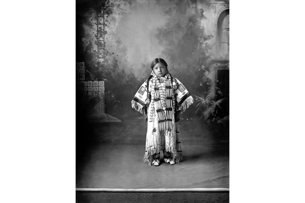 5. A girl wearing an intricately beaded dress
