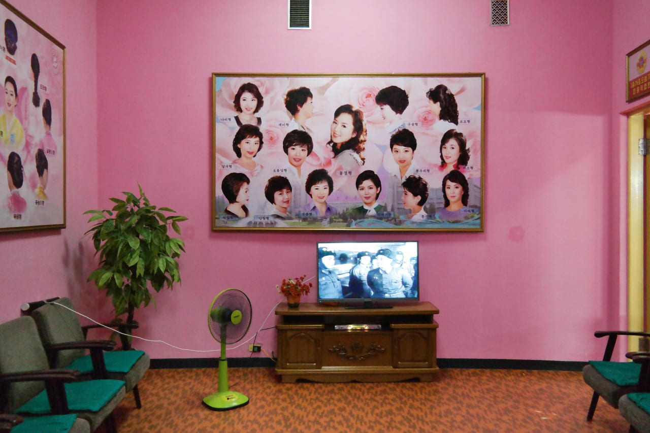 10. A Pink Room with Seating and Images of Women's Hair Styles