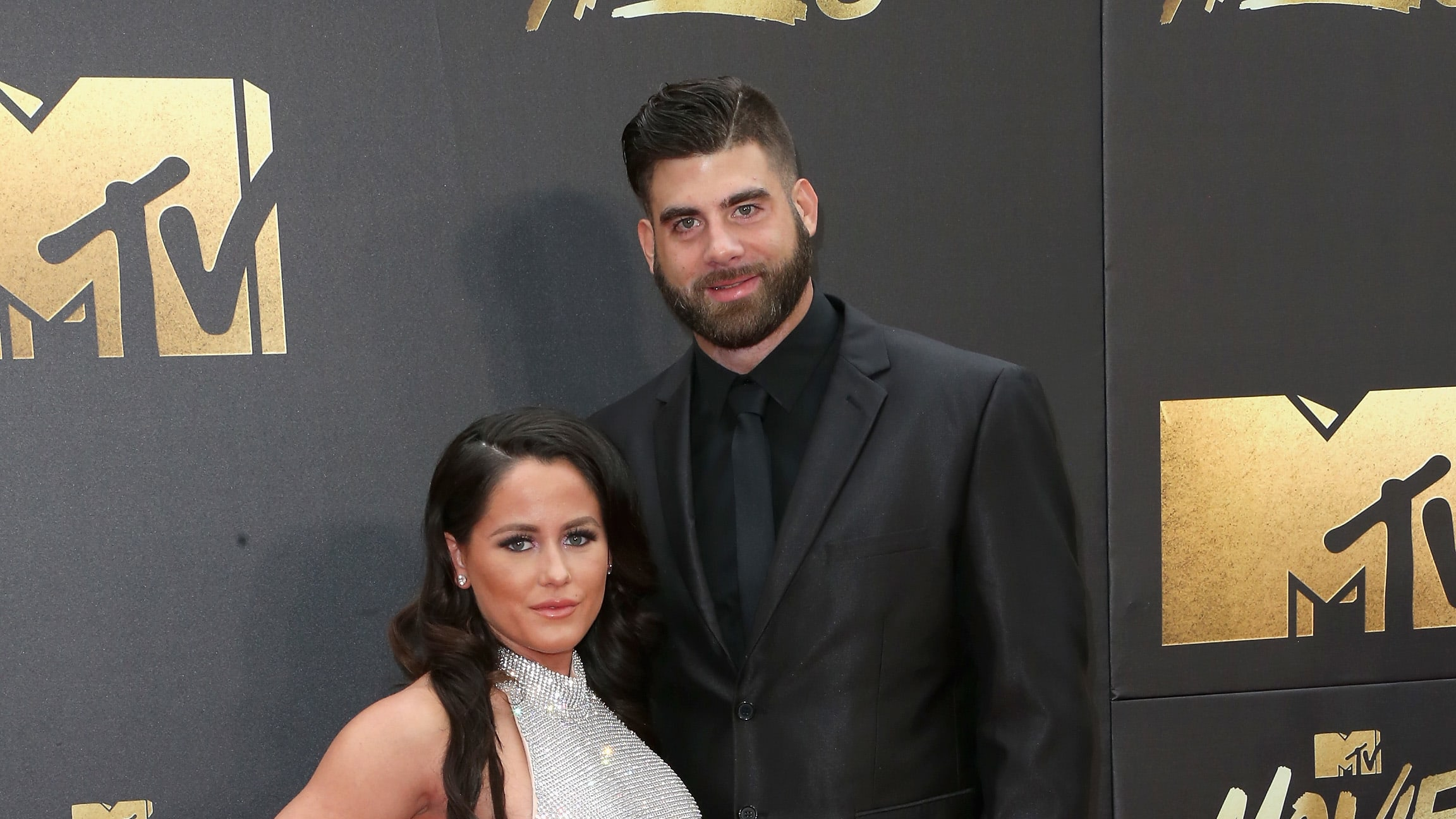 BURBANK, CALIFORNIA - APRIL 09:  TV personality Jenelle Evans (L) and David Eason attend the 2016 MTV Movie Awards at Warner Bros. Studios on April 9, 2016 in Burbank, California.  MTV Movie Awards airs April 10, 2016 at 8pm ET/PT.  (Photo by Frederick M. Brown/Getty Images)