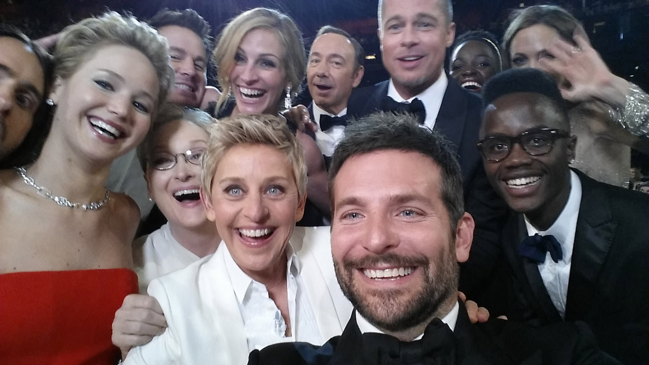 HOLLYWOOD, CA - MARCH 02: HANDOUT – EDITORIAL USE ONLY - In this handout photo provided by Ellen DeGeneres, host Ellen DeGeneres poses for a selfie taken by Bradley Cooper with (clockwise from L-R) Jared Leto, Jennifer Lawrence, Channing Tatum, Meryl Streep, Julia Roberts, Kevin Spacey, Brad Pitt, Lupita Nyong'o, Angelina Jolie, Peter Nyong'o Jr. and Bradley Cooper during the 86th Annual Academy Awards at the Dolby Theatre on March 2, 2014 in Hollywood, California.  (Photo credit Ellen DeGeneres/Twitter via Getty Images)