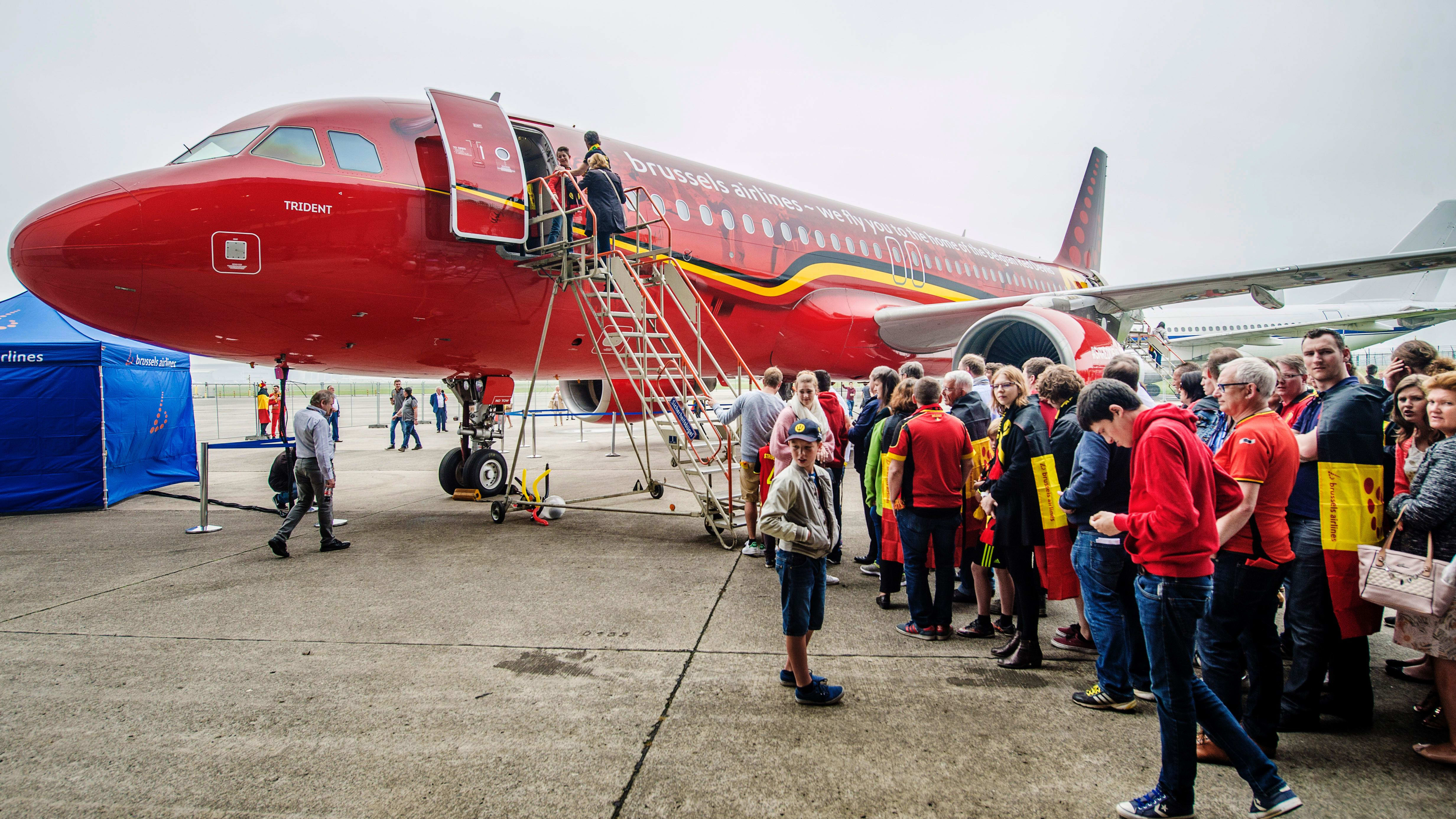 This picture taken on June 5, 2016 shows the Red Devils airplane of Brussels Airlines presented to some 500 fans of the Belgian national soccer team at Brussels airport in Zaventem. / AFP / BELGA / FILIP DE SMET / Belgium OUT        (Photo credit should read FILIP DE SMET/AFP/Getty Images)