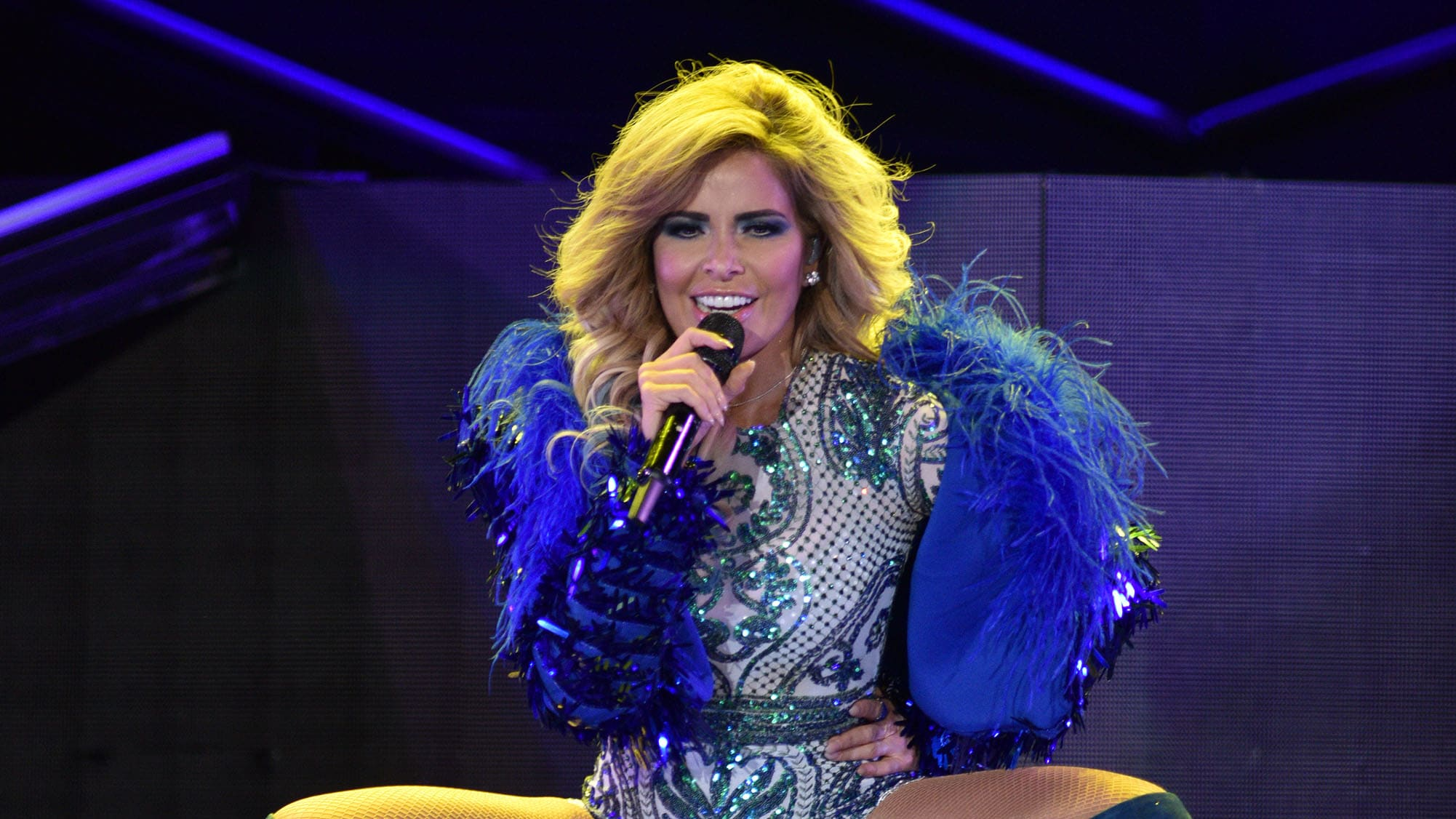 """DENVER, CO - MARCH 23:  Mexican singer Gloria Trevi performs during the """"VERSUS World Tour"""" at the Pepsi Center on March 23, 2018 in Denver, Colorado.  (Photo by Tom Cooper/Getty Images)"""