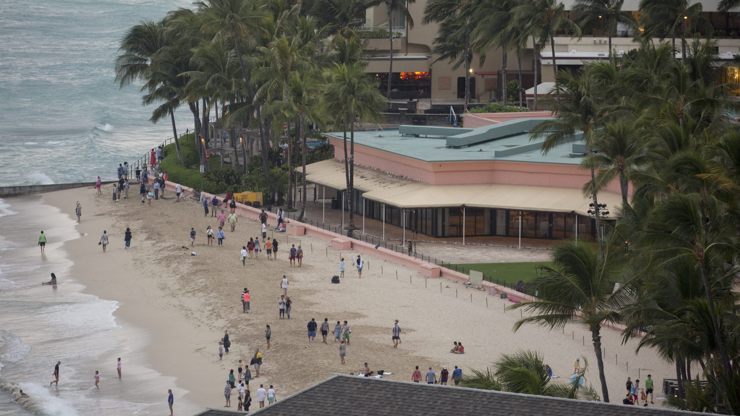 HONOLULU, HI - AUGUST 23: 2018   The threat of Hurricane Lane does not deter the tourists and locals from playing on the beach or in the ocean at the Royal Hawaiian as Hurricane Lane approaches Waikiki Beach on Kalakaua Ave on Thursday, August 23, 2018 in Honolulu, Hi.   (Photo by Kat Wade/Getty Images)