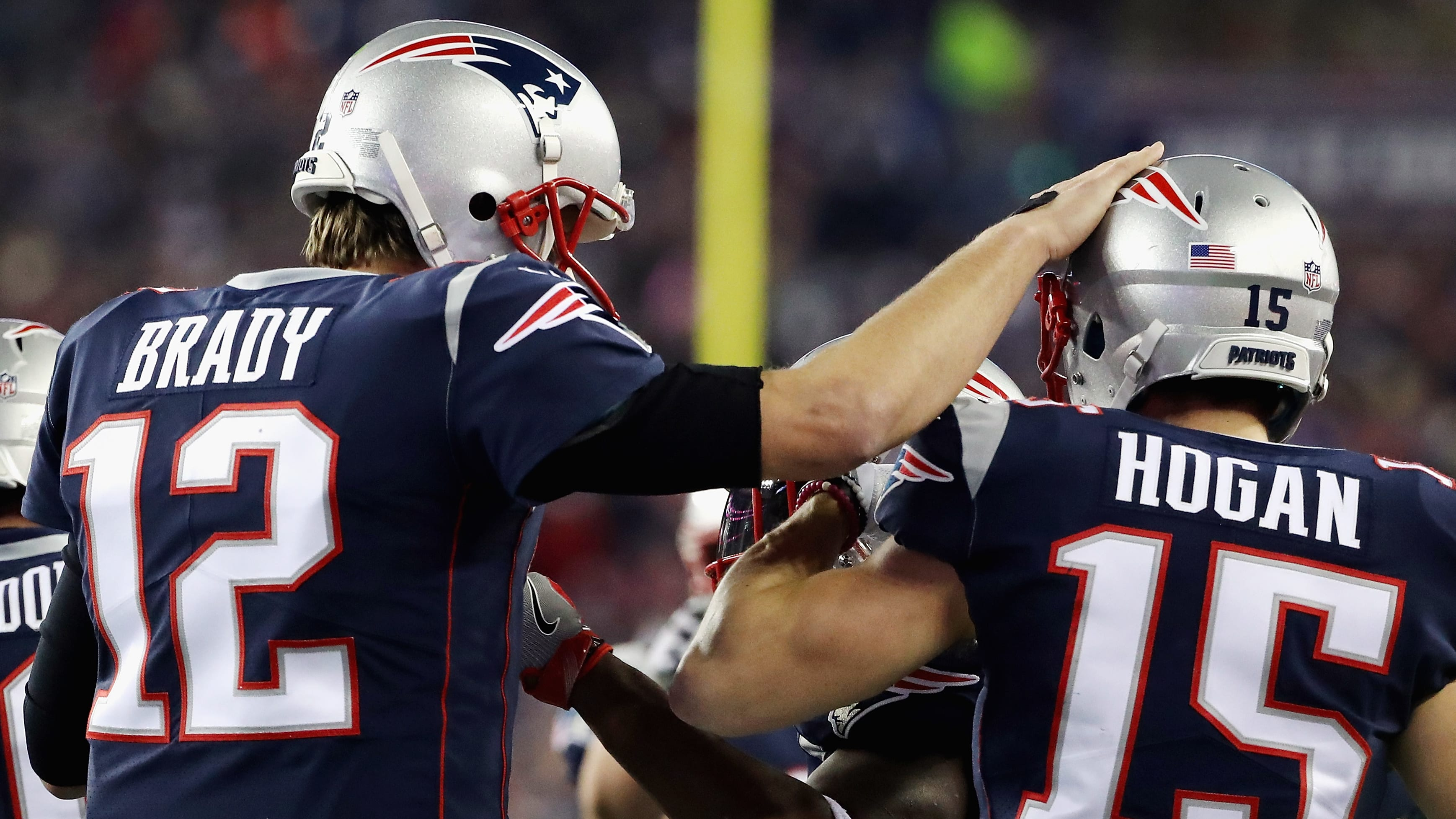 FOXBOROUGH, MA - JANUARY 21:  Tom Brady #12 of the New England Patriots celebrates a touchdown with Chris hogan #15 in the fourth quarter  during the AFC Championship Game against the Jacksonville Jaguars at Gillette Stadium on January 21, 2018 in Foxborough, Massachusetts.  (Photo by Elsa/Getty Images)